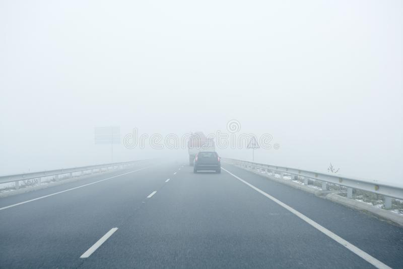 Foggy Gray Road, Cars Driving Into The Fog Stock Photography