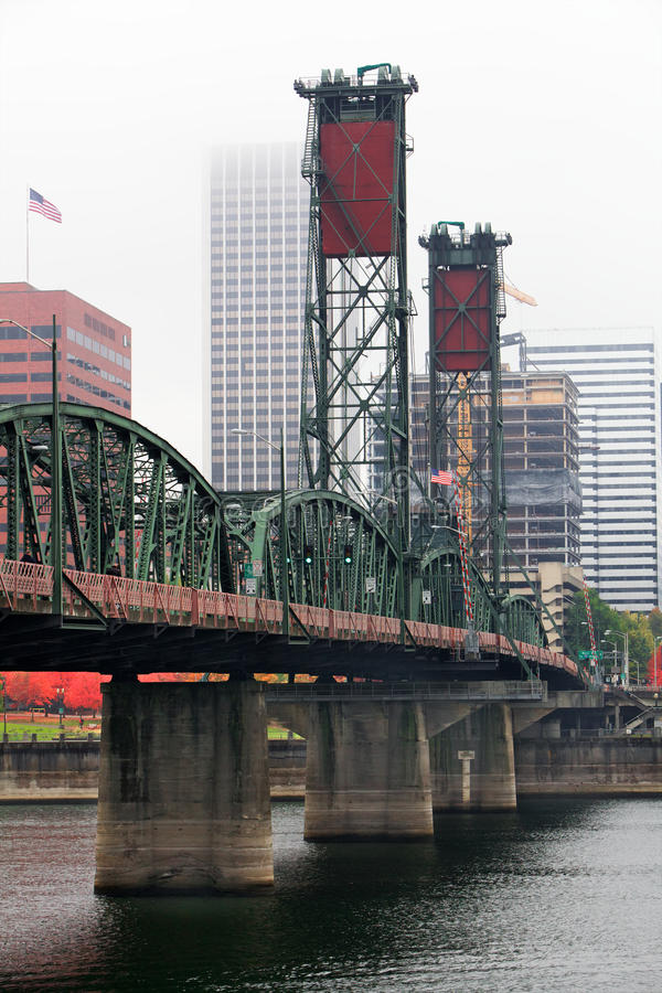 Foggy Hawthorne Bridge. Foggy day with a diminishing view of the Hawthorne Bridge on the Willamette River stock image
