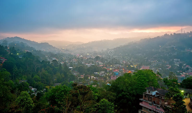 Foggy Kandy, Sri Lanka at the sunrise. Foggy aerial panorama of Kandy, Sri Lanka at the sunrise stock image