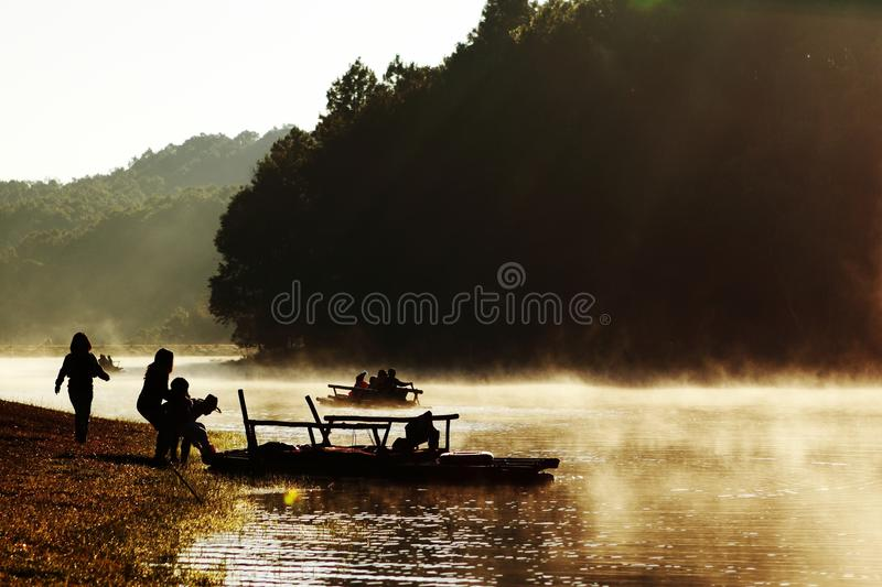 Foggy on lake when sunries royalty free stock images