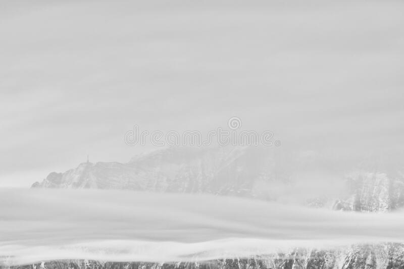Foggy landscape. Carpathians Mountains, Bucegi range with Cross in top of Caraiman Peak stock image