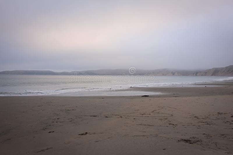 Foggy landscape view along the Drakes Beach, Point Reyes National Seashore, Marin County, California. Drakes Bay is a 4-mile wide bay  along the Point Reyes stock photography