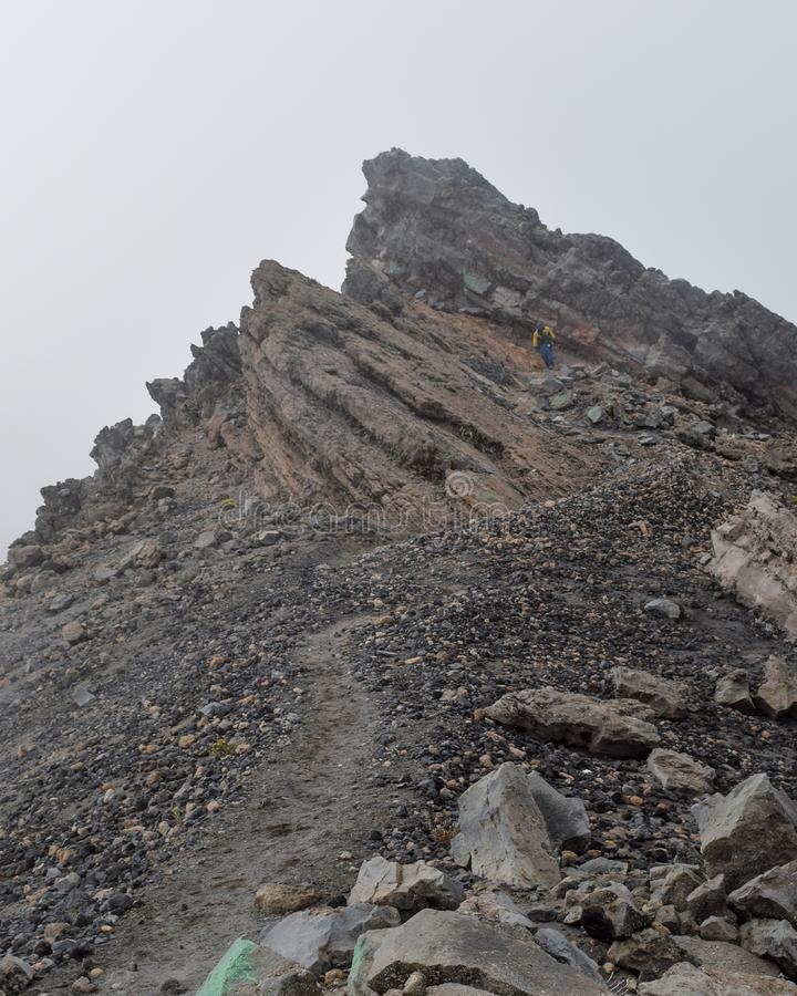 Foggy landscapes at Mount Meru. Rock formations against a foggy background at Mount Meru, Arusha National Park, Tanzania  hike trek trekking landscape travel stock photos