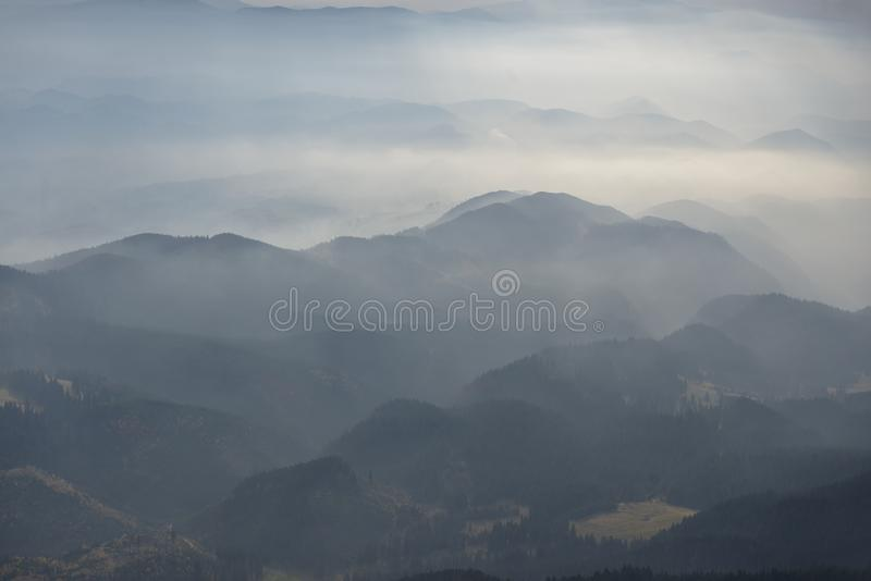 Foggy layered mountain landscape in Piatra Craiului mountains royalty free stock photos