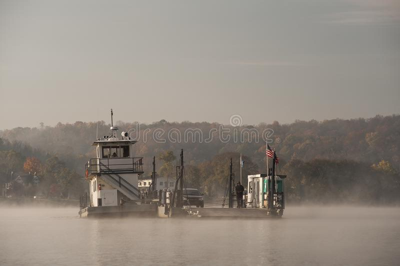 Foggy Morning - Augusta Ferry - Ohio River - Ohio & Augusta, Kentucky. A foggy morning view of the Augusta Ferry running across a misty Ohio River between Ohio royalty free stock photography