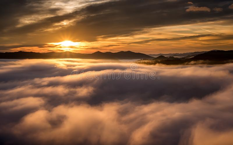 Foggy morning in Bucovina at sunrise in autumn time , Romanian landscape.  royalty free stock images