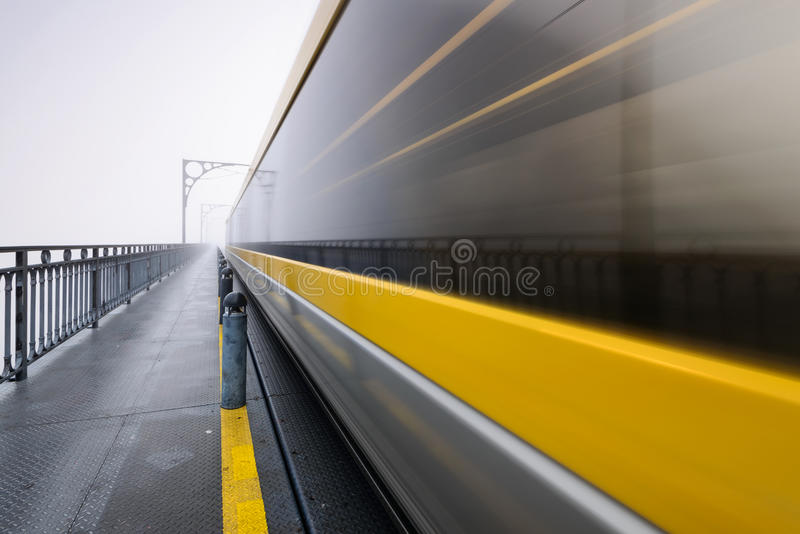 Foggy morning at Dom Luis Bridge in Oporto city stock photos