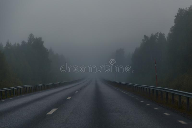 Foggy morning on the road royalty free stock photos