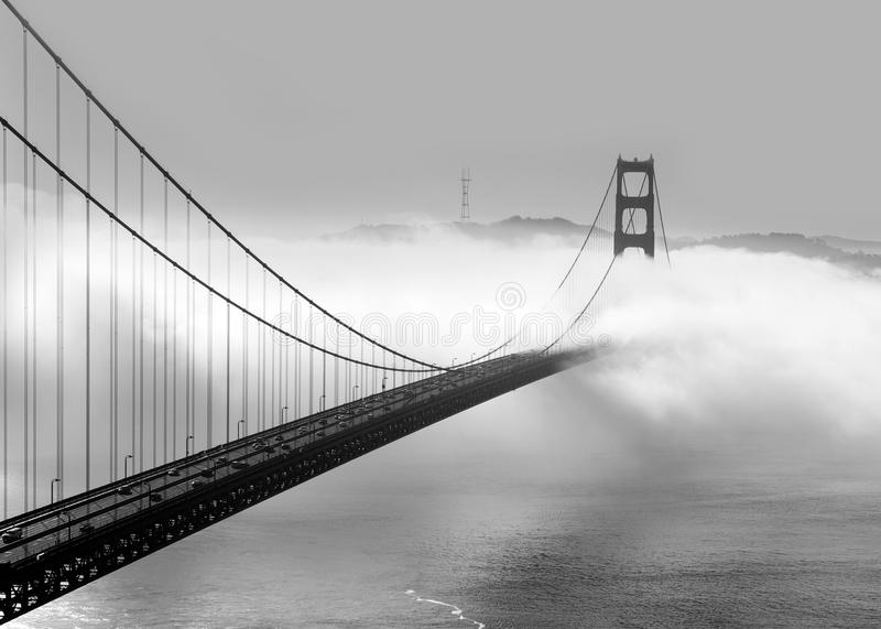 Foggy morning on the Golden Gate. Panoramic view of the western span of the Golden Gate Bridge on a foggy winter morning viewed from Battery Spencer, a Fort royalty free stock photo