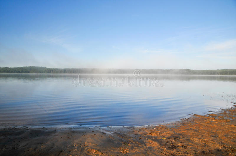Foggy morning on a lake in Abitibi, Québec. Landscape in Abitibi, Québec, Canada stock image