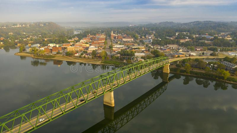 Foggy Morning Over the River and Main Street Marietta Ohio Washington County. A scenic byway feeds tourists into the downtown area in the settlement called royalty free stock image