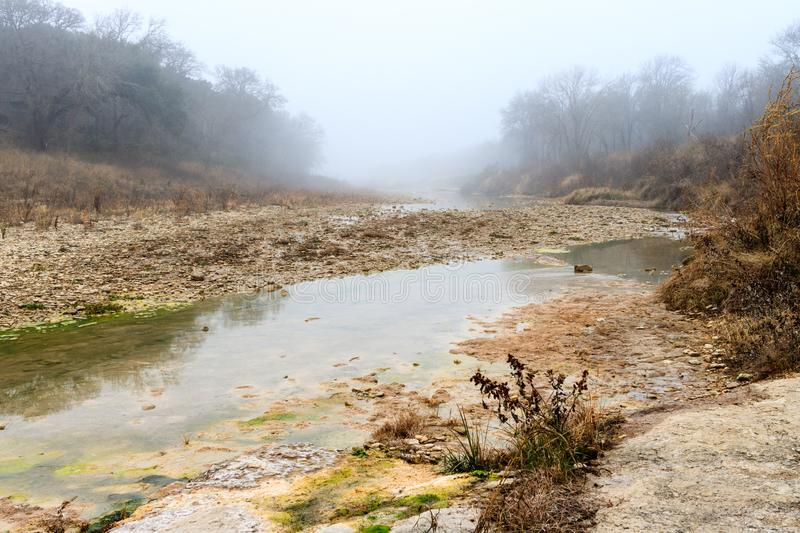 Foggy Morning on the San Gabriel River near Georgetown Texas. Standing on the gravel bar royalty free stock images