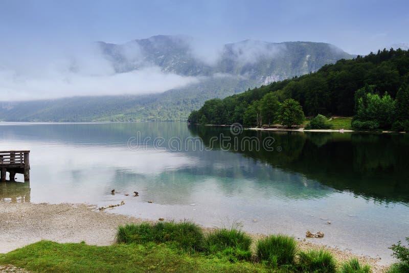 Foggy morning on the shore of Lake Bohinj, Slovenia. royalty free stock photos