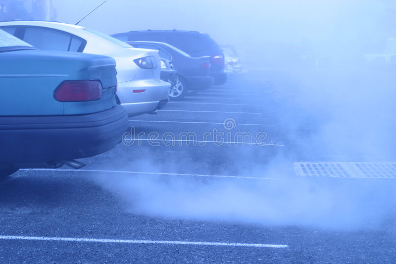 Foggy morning start to the day. THe unknown,. Very cold & foggy blue morning.Adverse weather conditions for travel. Very early morning. Row of parked automobiles royalty free stock images