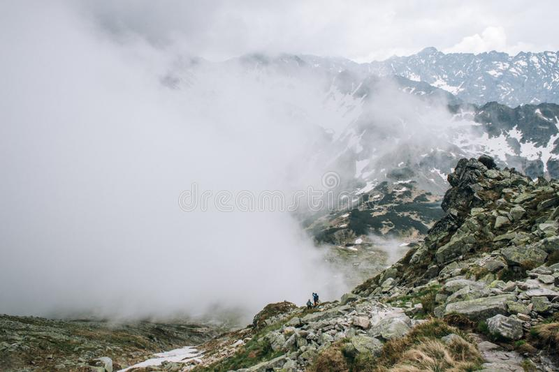 Foggy morning view from Kozi Wierch peak in Tatra Mountains valley of Five Lakes stock photography