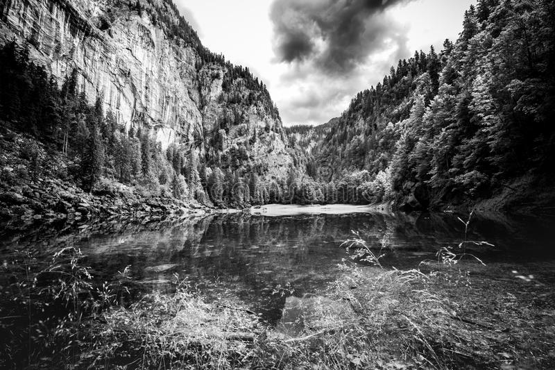 Black and white lake landscape with mountains. Cloudy and foggy view, abstract nature panorama royalty free stock images