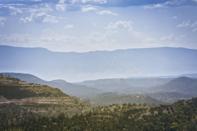 Mountain Ridge. Foggy mountain ridge with cloudy blue skies stock photography