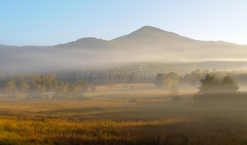 Foggy Mountain Views At Sunrise Stock Photo