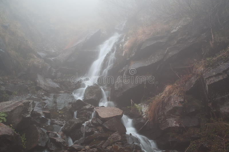 Foggy mystery waterfall stock images