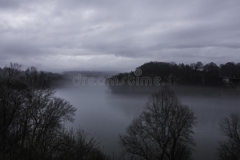 Foggy Potomac River with overcast skies. Great View of the Potomac River behind the Bavarian Inn Shepards Town WV royalty free stock images