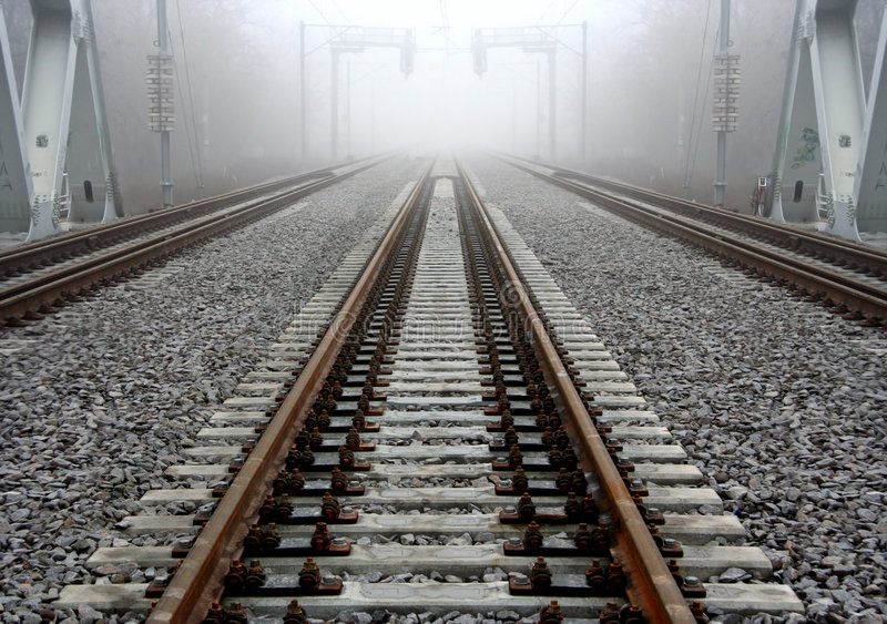 Foggy railroad track stock photo