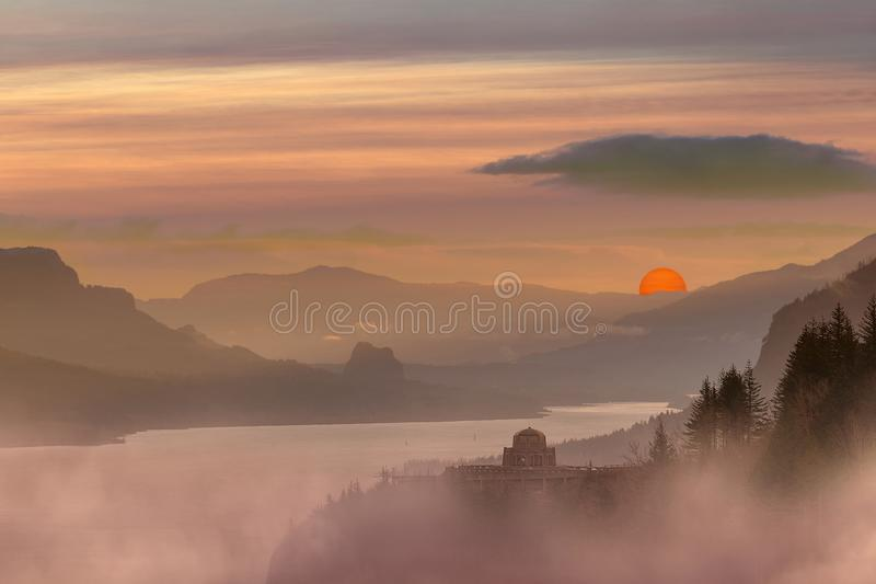 Foggy Red Sun Sunrise at Columbia River Gorge. Foggy hazy red sun sunrise morning at Crown Point in Columbia River Gorge Oregon stock image