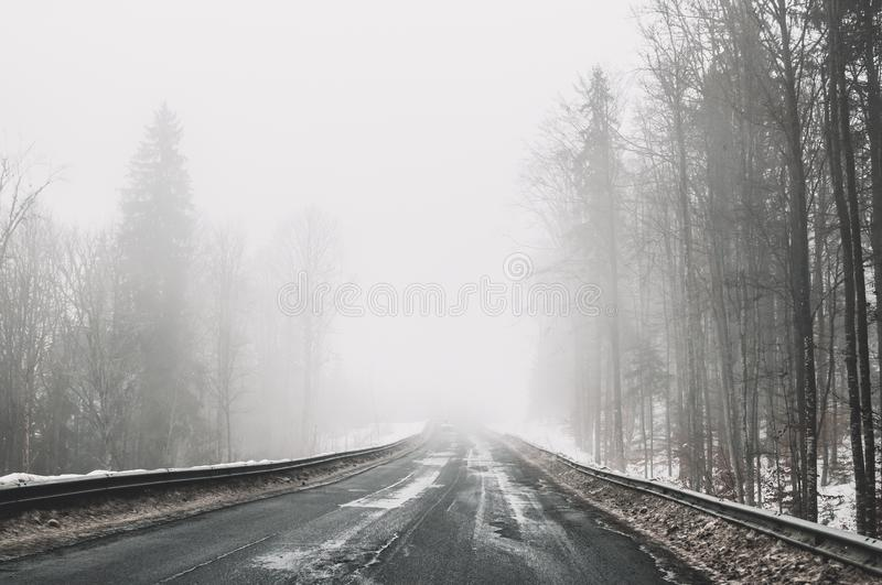 Foggy road in the mountains. Winter trip to the Carpathian Mountains, Eastern Europe stock photo