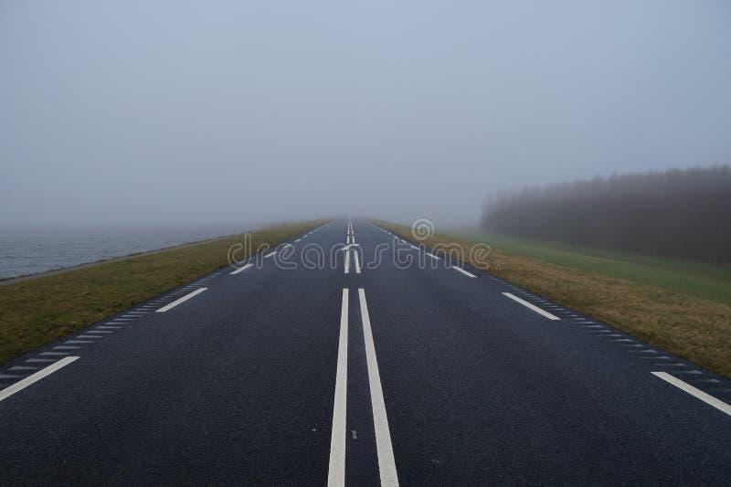 Foggy Road - Oostvaardersdijk. Almere, Flevoland royalty free stock photos