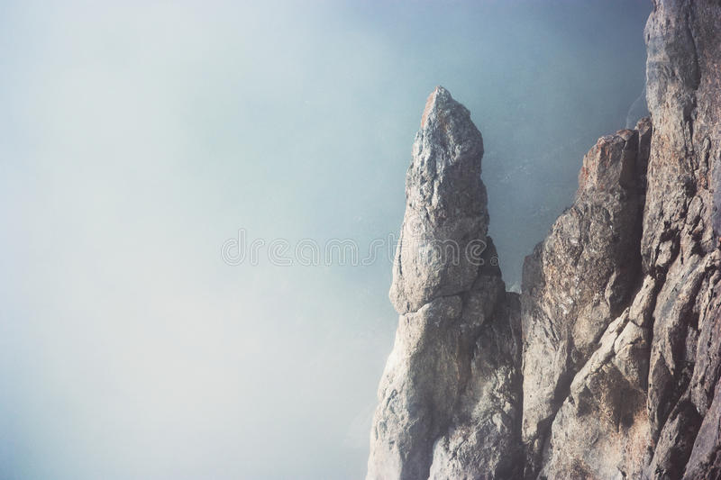 Foggy rocky Mountains cliff Landscape minimalistic. Style Travel serene scenic aerial view moody weather stock photography