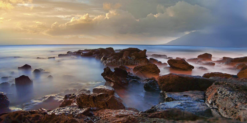 Foggy sea rocks with mist stock photography