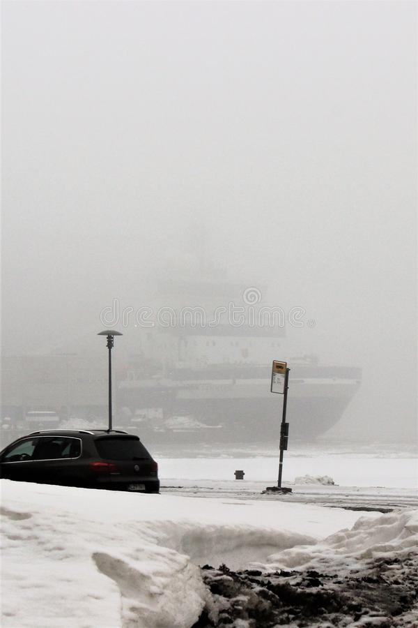 Helsinki, Finland, March 2012. Foggy spring morning in the seaport overlooking the ships. royalty free stock photography