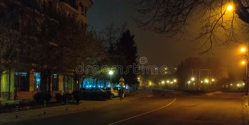 Foggy streets of the night Pomorie in Bulgaria stock photography