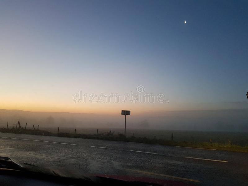 Foggy Sunrise over Distant Hills royalty free stock image