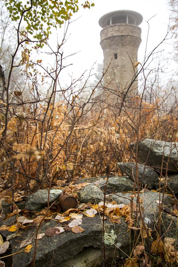 Foggy Tower Hidden in the Autumn forest stock images