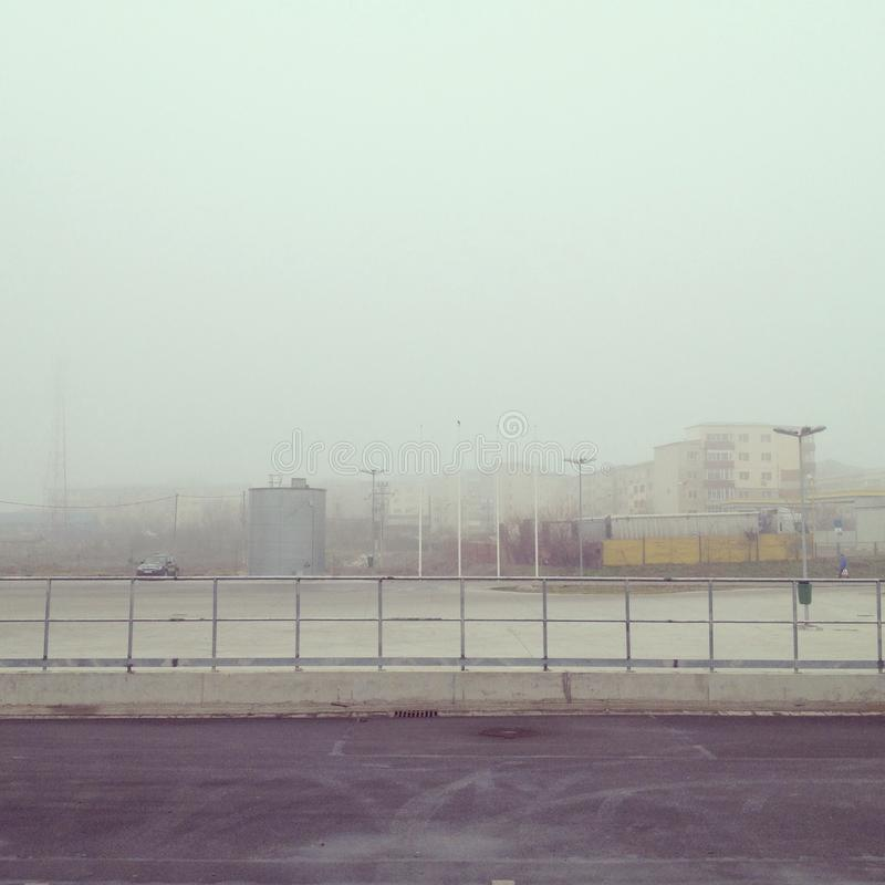 Foggy urban landscape royalty free stock photography