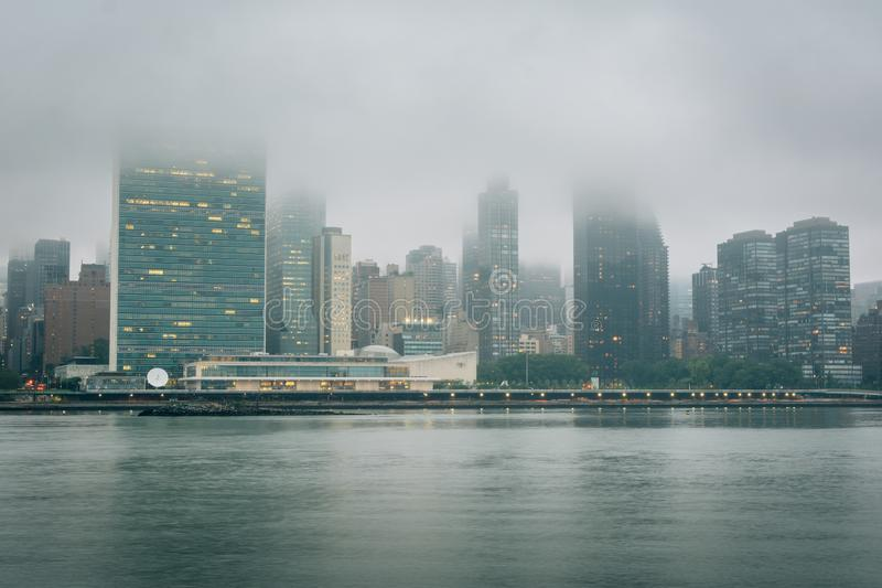 Foggy view of the Manhattan skyline from Gantry Plaza State Park, in Long Island City, Queens, New York City royalty free stock image