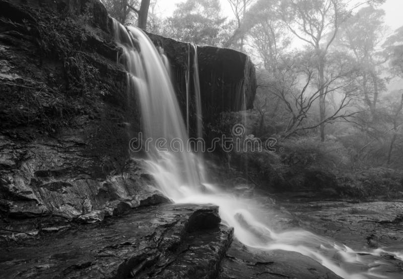 Foggy waterfall in Blue Mountains. Weeping Rock waterfall in the upper section of cascades fed by the Jamison creek, on a foggy rainy day in winter stock photography