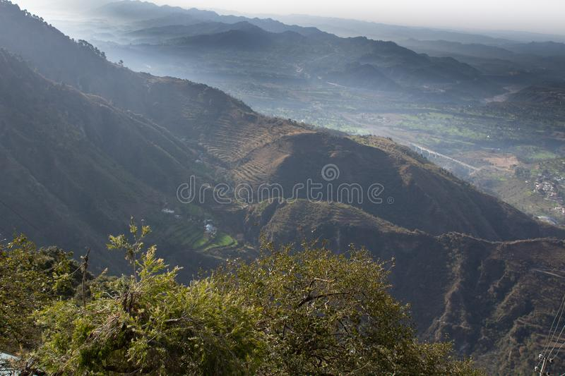 Foggy winter and mist covered hills in a mountain range. Camping concept royalty free stock images