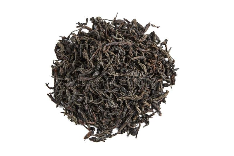 Foglie di tè secche allentate del tè nero Isolato immagini stock libere da diritti