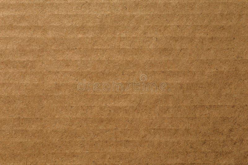 Foglio del cartone di carta marrone, fondo astratto di struttura fotografia stock