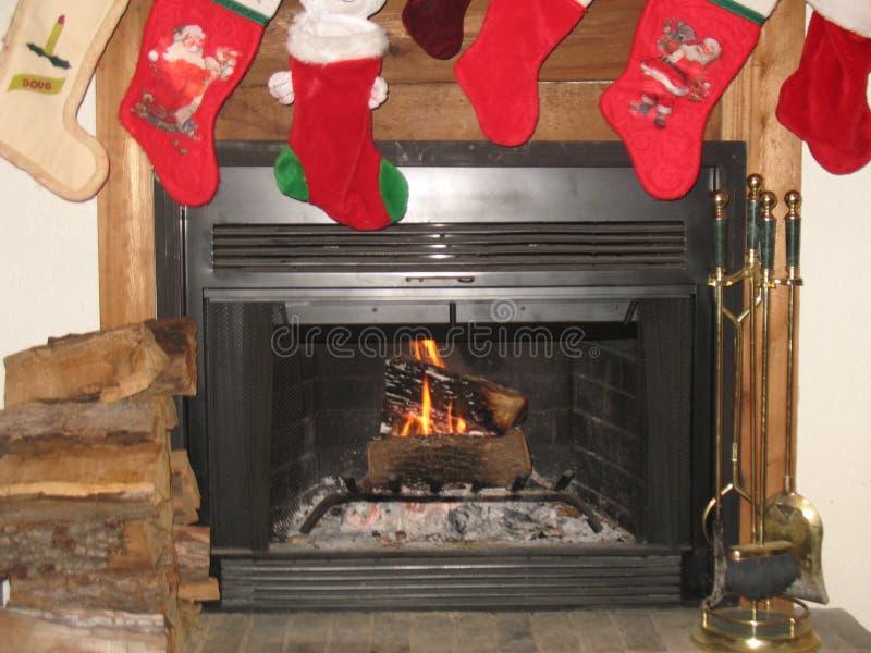 Fogo do Natal da família foto de stock