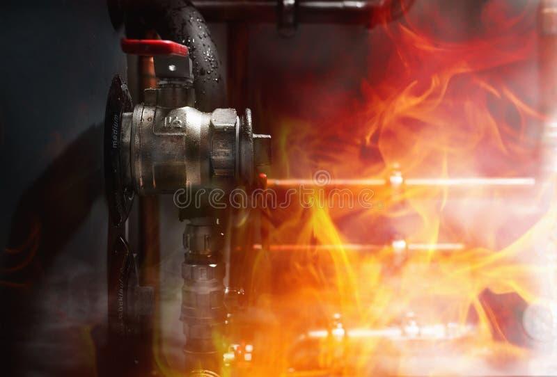 Fogo, fumo e vapor em uma sala de caldeira fotos de stock