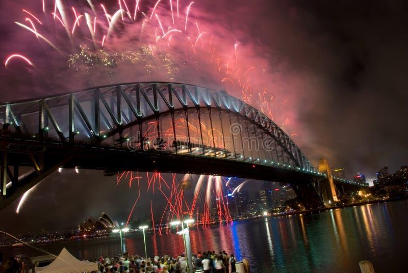 Fogos-de-artifício do ano novo de ponte de porto de Sydney imagem de stock