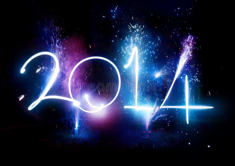 Fogos-de-artifício do ano novo feliz 2014 fotografia de stock royalty free