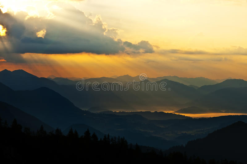 Fogy morning in the mountains. Fogy morning in the summer Alps stock image