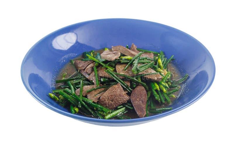 Foie de porc frit par émoi avec la ciboulette chinoise photographie stock