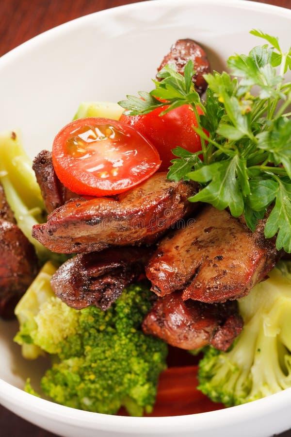 Foie de poulet avec des légumes photo libre de droits