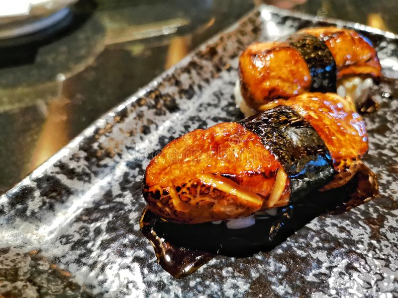 Foie gras sushi on plate in japanese restaurant stock image