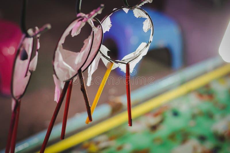 Foire de papier utilisée déchirée de temple de jeu de pêche de scoop images libres de droits