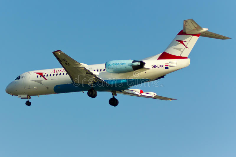 Fokker 70 Plane. Austrian Airlines Fokker 70 Plane in the sky royalty free stock photography